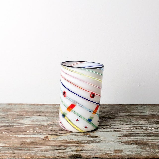 A Vintage Italian Murano glass tumbler vase, in white glass with a multi colored swirl pattern, circa 1970.