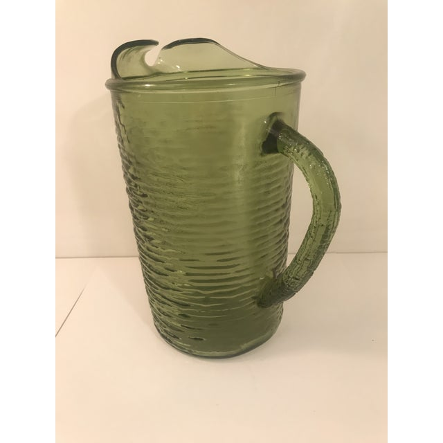 Vintage Anchor Hocking Soreno green pitcher with ice lip. 3 more available in green. Matching glasses in multiple sizes...