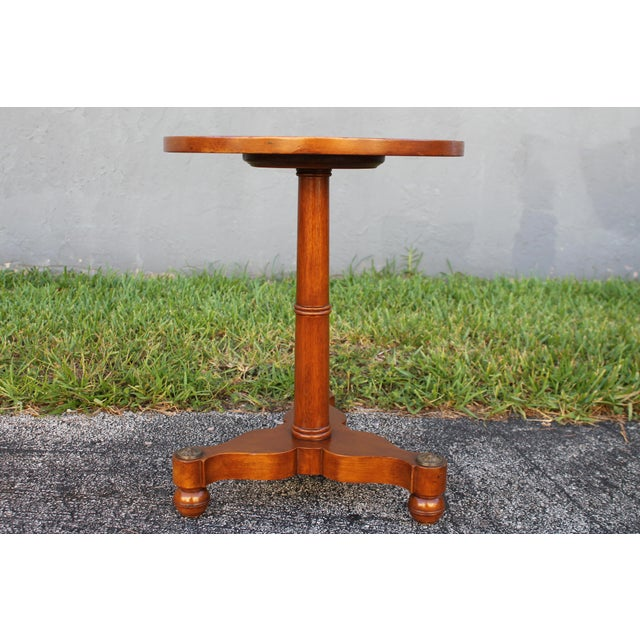 An opulent vintage exotic walnut carved side/ accent table. Stunning base.