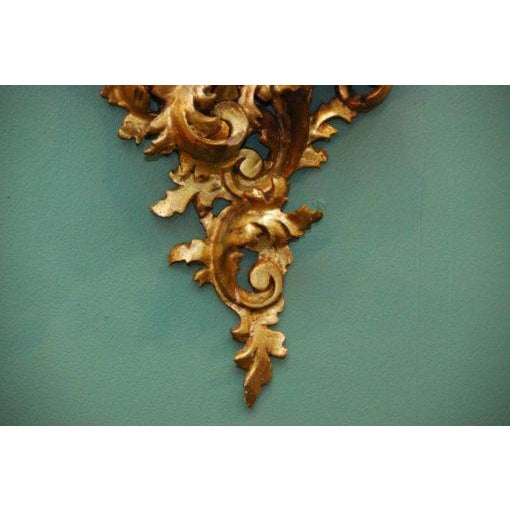 Pair of ornate gilt wood wall shelfs. Made in the early 20th century in the style of French.