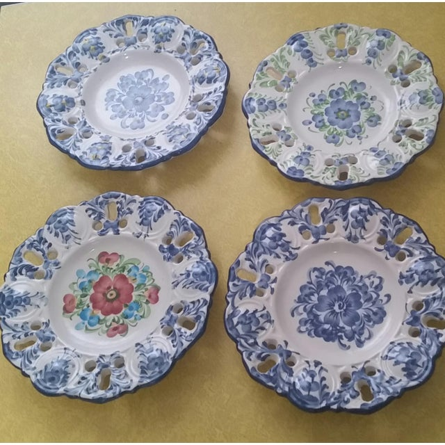 Here's a pretty cottage style set of four decorative hanging plates that were made in Portugal by Jay Willfred for Andrea...