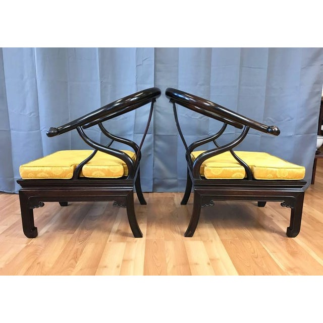 An exceptional pair of generously proportioned Chinese horseshoe chow chairs in stained solid rosewood, dating from...