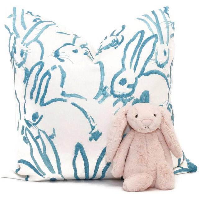 Add a pop o aqua to you room with this charming bunny pillow cover. Aqua bunnies on a white linen background. Fabric...