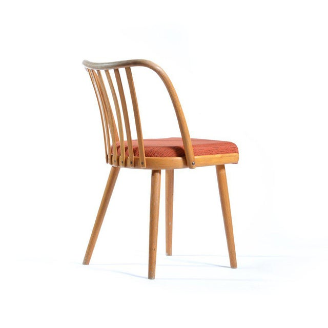 This beech bentwood chair was designed in the 1960s by Antonin Suman for TON (formerly Thonet), and has been newly...