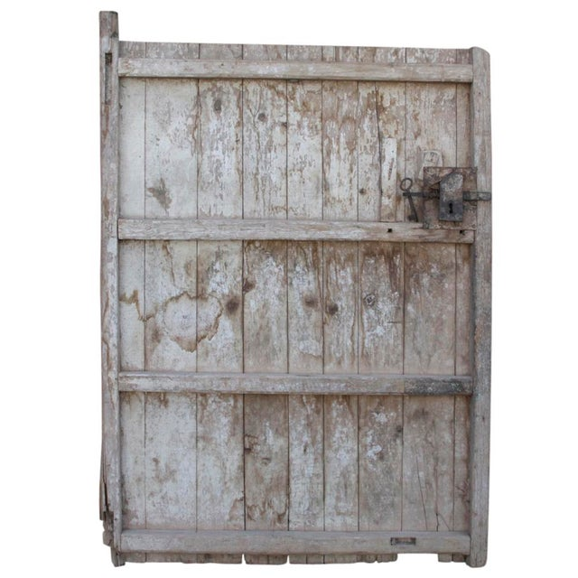 This beautiful 19th Century door was made using cedar planks, and is decorated with carved details and tribal scenes....