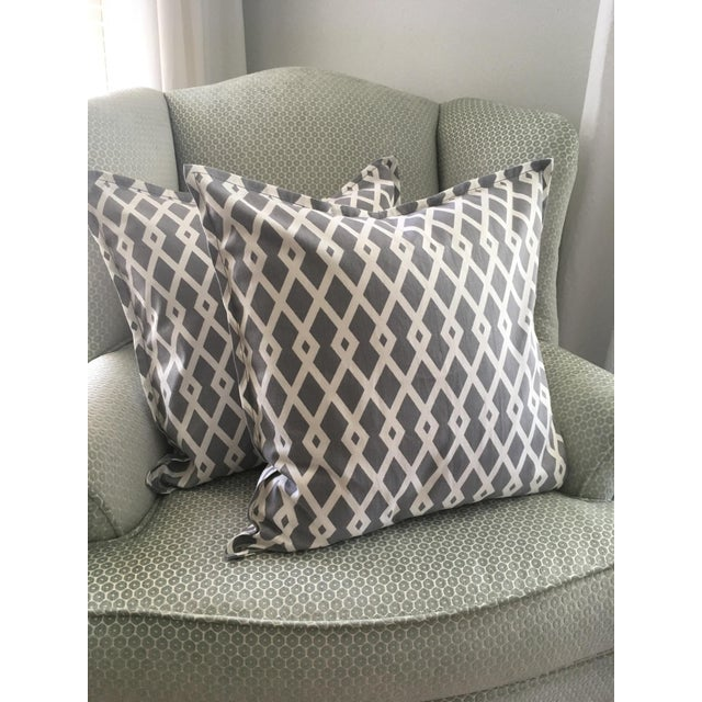 Pair of snappy gray geometric pillow cases that harken to the trendy ikat design, but offer a more tailored look. The warm...
