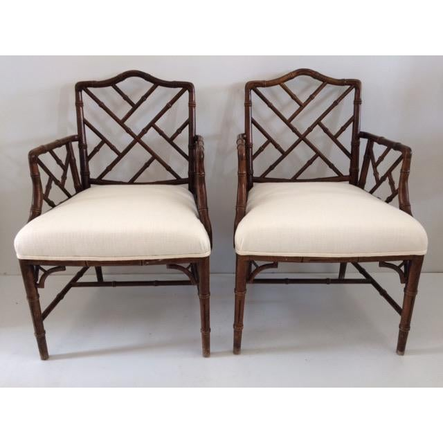 Boho Chic Faux Bamboo Chairs Upholstered in White Todd Hase Fabric. Perfect for a modern home.