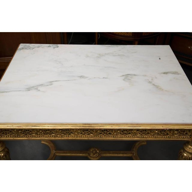This is a very simple; yet elegant, and delicate, Louis XVI style giltwood centre table with a Carrara marble inset top...