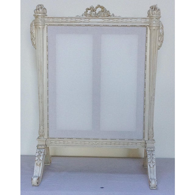 Great looking antique carved wood with painted finish decorative fire screen. This screen has a panel which can be...