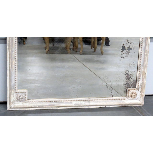 Louis XVI style distressed painted wall mirror. Made in the early 20th century.