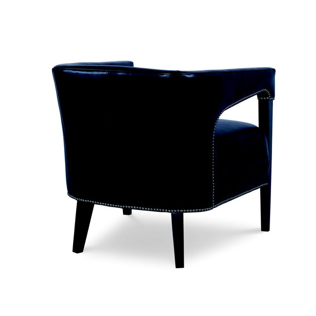 A refined chair from Century Furniture's Century Trading Company Collection. The luxurious piece is upholstered in...