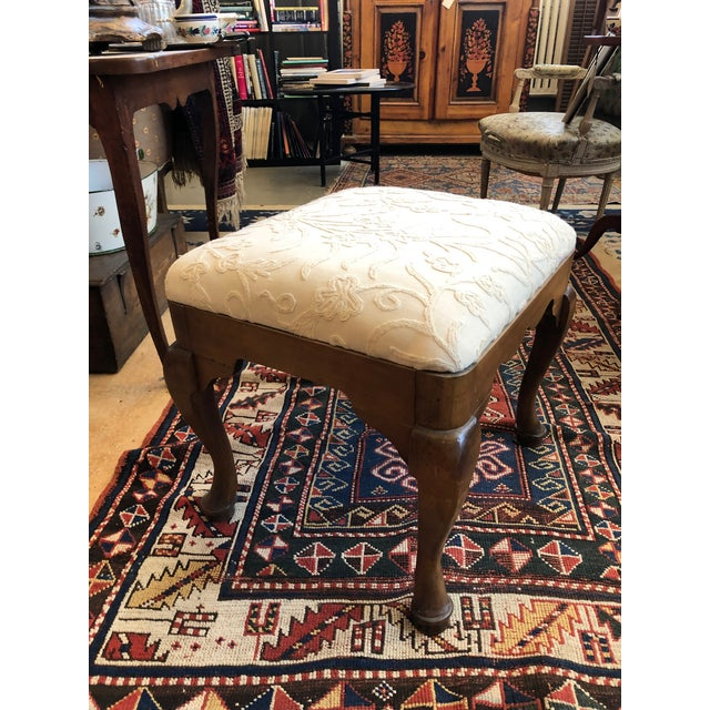 Late 19th Century Walnut and Crewel Upholstered Queen Anne revival Stool/Bench. This is a nicely proportioned piece that...