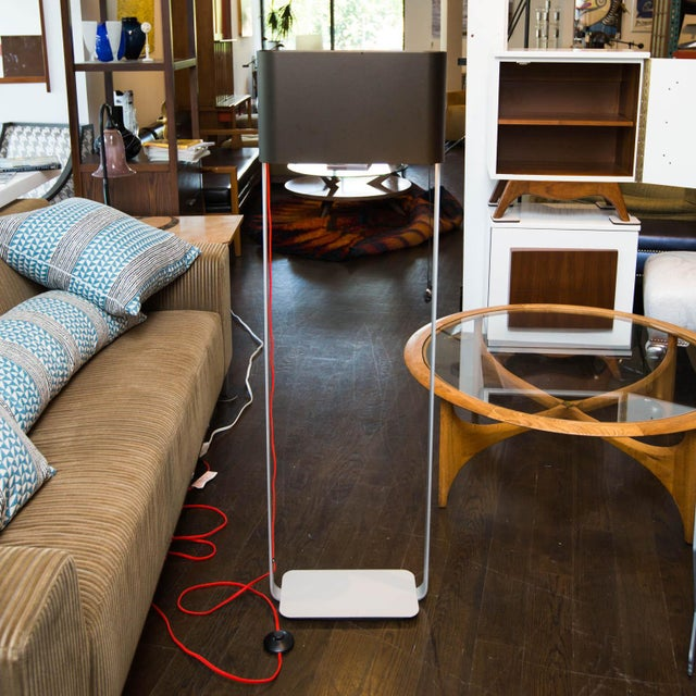 Long-discontinued floor lamp that shines light downward and as a torchiere.