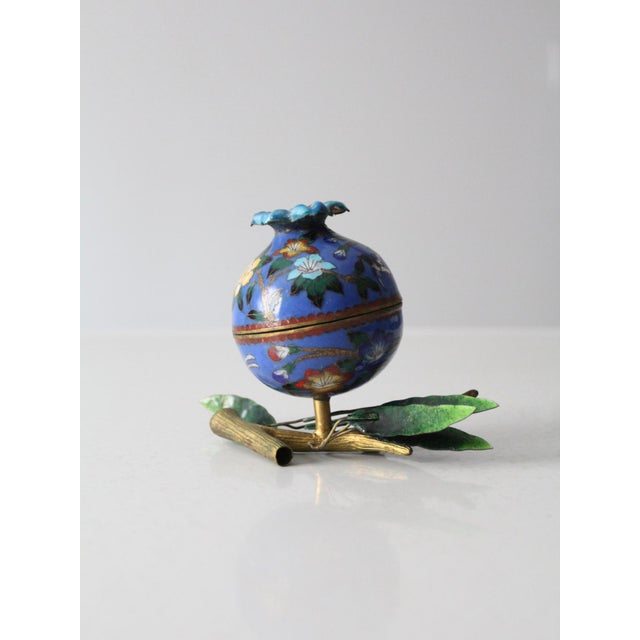 A rare find. This is an antique cloisonné sculptural box. A cloisonne enamel and brass round box nests atop a brass branch...