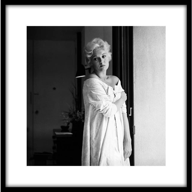 """Kim Novak at home in Los Angeles, 1956. 11"""" x 14"""" silver gelatin fiber based print signed on verso by the photographer,..."""