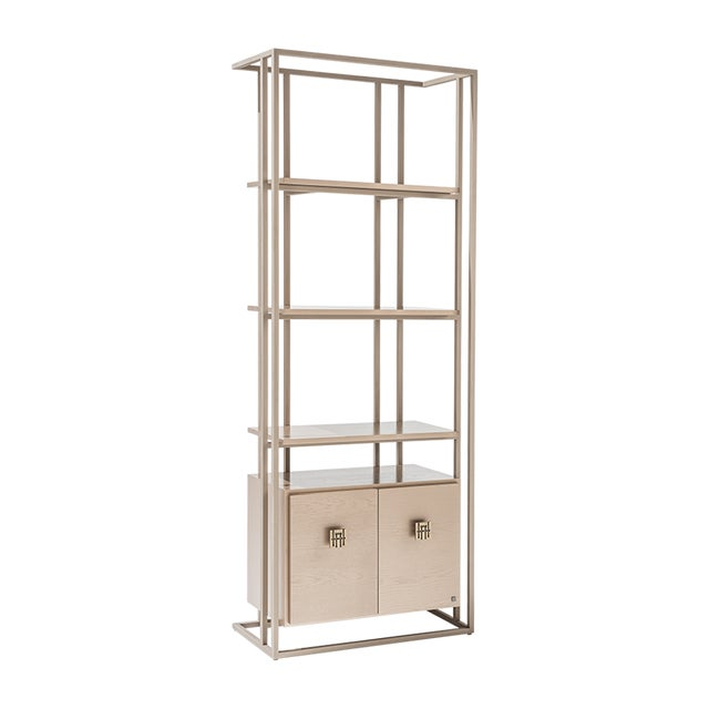 Metal Bookcase structure with wood eucalypt doors. This piece complements with central entertainment Bolero BR30-200. It...