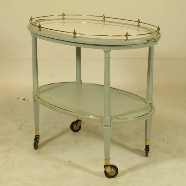 An early 20th-C. English painted tea cart with original gray painted finish, inset milk glass top surface and solid brass...
