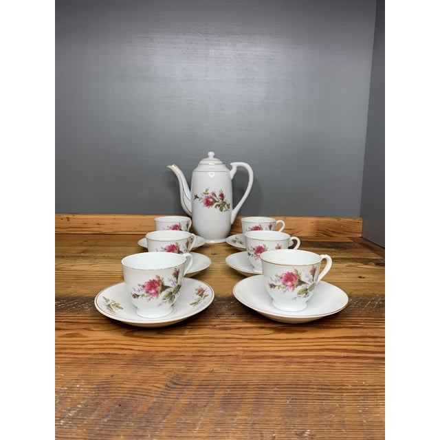 Tea set with 6 cups, saucers, and tea pot. Super cute set! Made in Japan. Cups are 2x2 Tea pot 7.5L x 3 D x 7 Plates 4 3/4 in