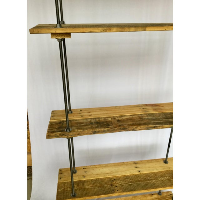 5 Shelves and the depth is between 10 to 11 inches, using 3 boards for each shelf. Fully adjustable between shelves....