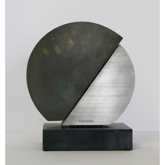 Great geometric piece in brushed stainless and mirror polished brass by Brazilian artist Dolly Moreno. The piece is marked...