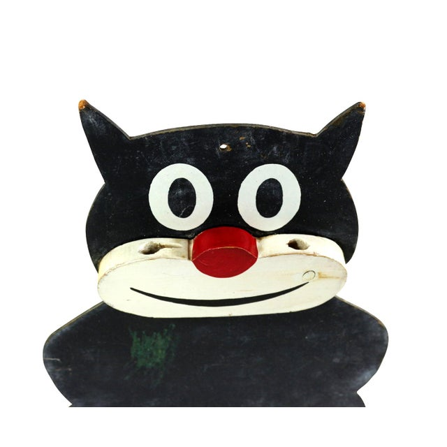A charming and hard to find Felix the Cat chalkboard. His face is made of wood and have holes to hold the chalk. The chalk...