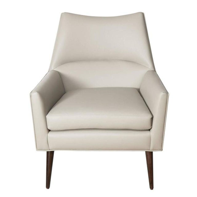 "M|n Originals McCabe arm chair .The chair is detailed with single loose seat cushion on solid turned legs. Seat Height-17""..."