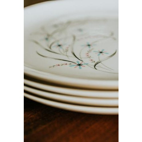 I fell in love with the soft whimsical pattern on these just-off-white dinner plates. Cute little starbursts are...