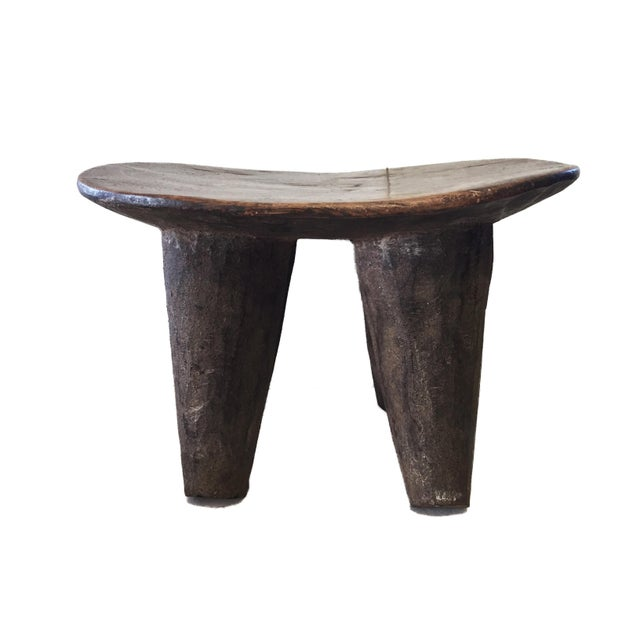 Superb African Senufo kids milk stool on four tapered legs with an abstract form . Carved from one piece of wood Senufo...