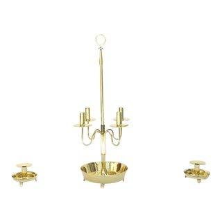 Polished Brass Three-Piece Candelabra Set by Tommi Parzinger For Sale