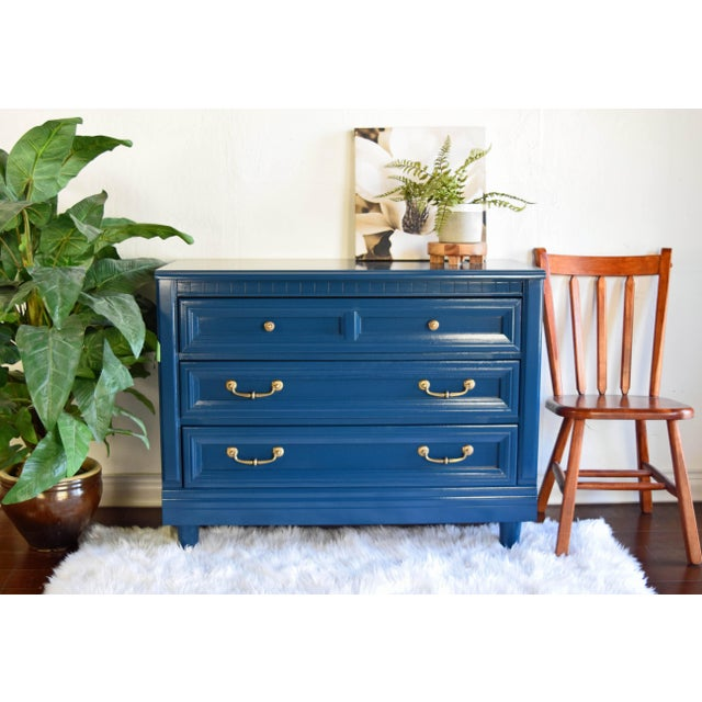 This beautiful low boy dresser was refinished in Moscow Midnight by Sherwin Williams. Handles were polished to bring back...