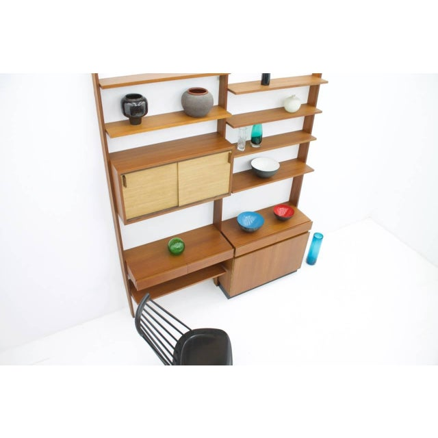 Rare teak shelf system by Dieter Waeckerlin with seagrass sliding doors. One cabinet with two sliding doors in seagrass...