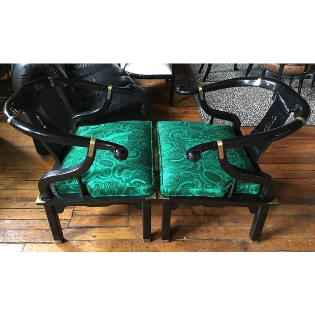 Pair of Hollywood Regency Century Furniture lounge accent armchairs in the style of James Mont. Black lacquered wood...