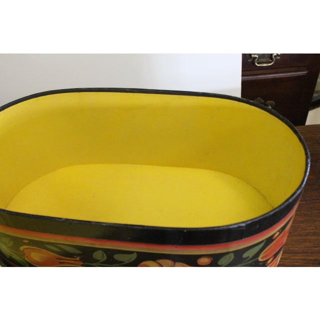 Unique reproduction band box for hats. With floral and figurative details in tropical colors of yellow, orange, green, and...