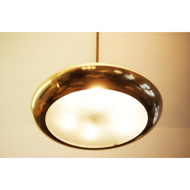 This pendant was designed by Joseph Hurka in the 1930s and was produced in Czechoslovakia by Napako in 1938. The lamp...