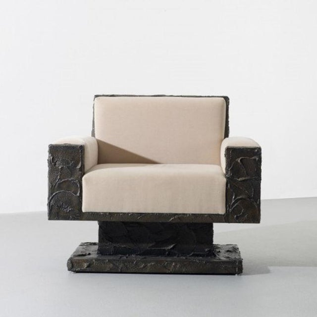 A sculpted bronze over plywood armchair by Paul Evans, American C.1969 This work is unique. This chair was designed for...
