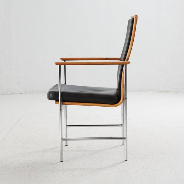 Frame in rosewood, steel legs, upholstered in black leather, made in Denmark in the 1970s. Perfect original condition...