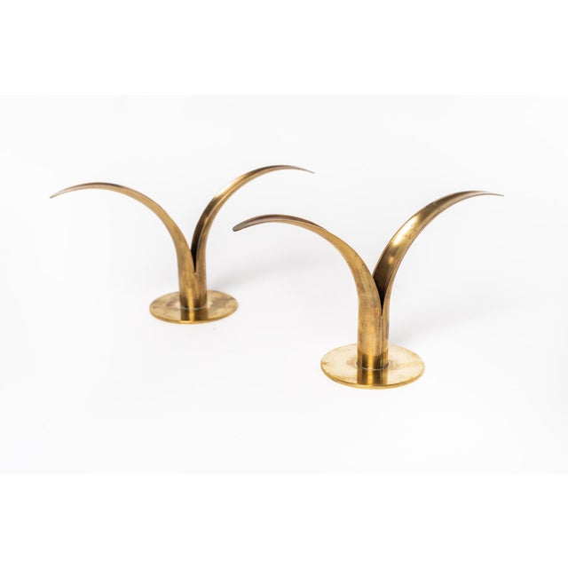 """This pair of iconic Liljan """"Lily"""" candlestick holders was designed by Ivar Ålenius-Björk in 1938 bridging Art Deco and mid..."""
