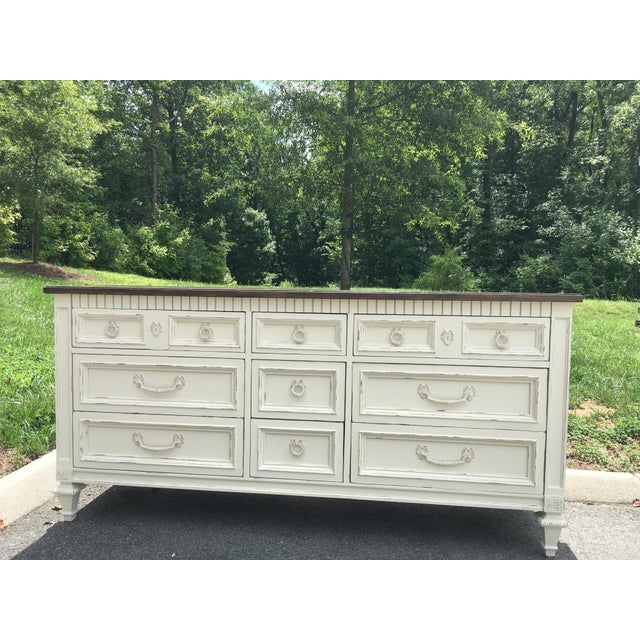 Quality Thomasville duo has been hand-painted in a soft off-white and features espresso-stained tops. Set also features:...