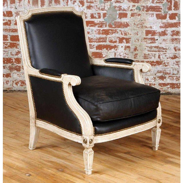 Pair painted and parcel gilt Hollywood Regency Maison Jansen black leather arm or bergere chairs. These finely constructed...