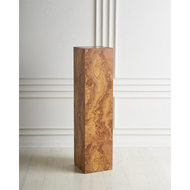 """A tall burl effect pedestal perfect for displaying art or a plant. Dimensions: 48""""H x 11 5/8""""D Condition: One area of..."""
