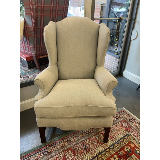 This is an absolutely beautiful vintage wingback. The mahogany frame is in great condition. Entirely reupholstered in 2021...