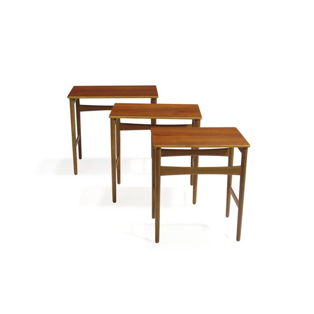 Hans Wegner Danish teak and oak nesting tables finely restored and in excellent condition. Stamped.