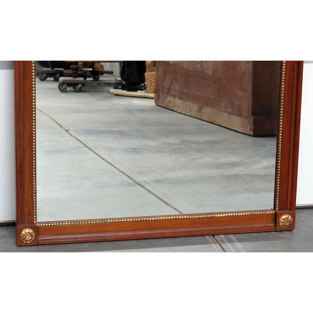 Kindel Furniture Regency style wall mirror with gilt accents.