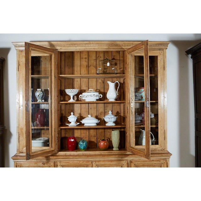 This extremely large pine french cabinet has four upper doors and four lower doors with shelving. The cabinet has been...