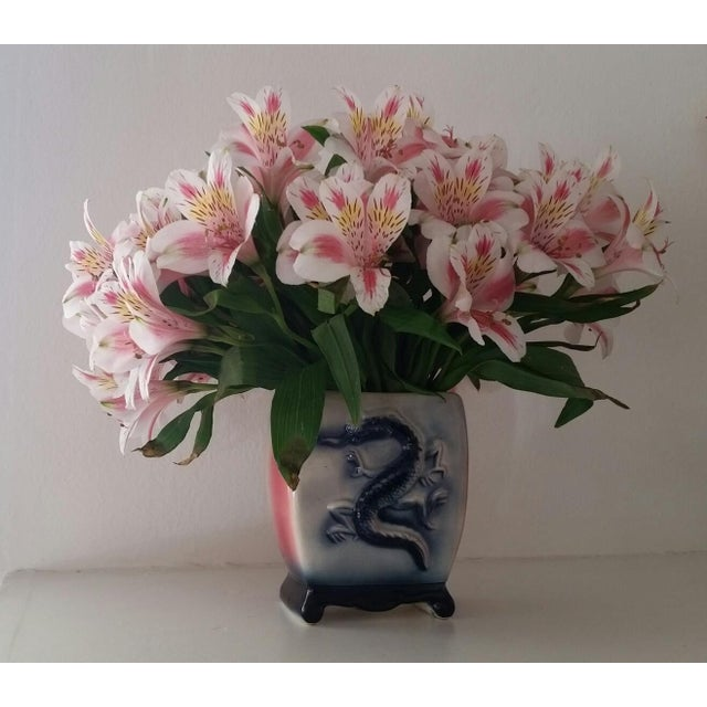 Edgy and sweet mid century ceramic dragon vase finished in a cream, navy and fuscia ombre glaze. Just as perfect for...