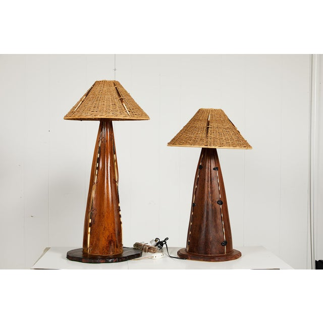 Unusual 20th century friendly pair of Folk Art lamp bases creatively made of palm frond seed pods. The palm fronds were...