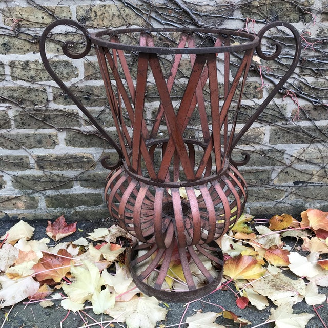 Older metal piece. Decorative as is or as topiary for your garden.