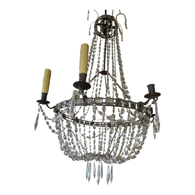 18th Century French crystal chandelier with iron bobeches. 6 lights. US wired. Square crystals mounted on circular frame....