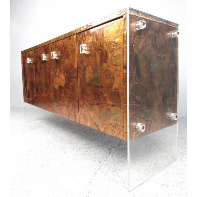 This unique vintage sideboard features the unique design style of Milo Baughman, while utilizing hammered patchwork metal...