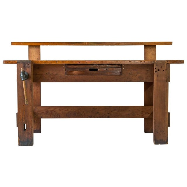 Early 20th C. carpenter's workbench with back shelf, drawer and operational vice. With home-friendly proportions and open...